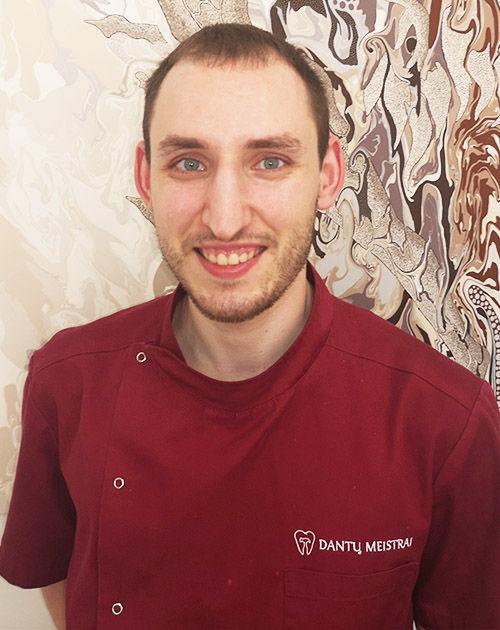 odontologas Jaroslav Komiago